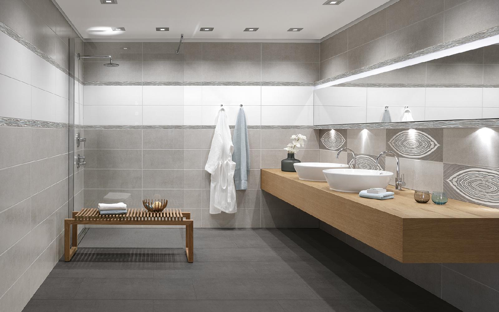Badezimmer Mit Grauen Fliesen Und Waschtisch Aus Holz